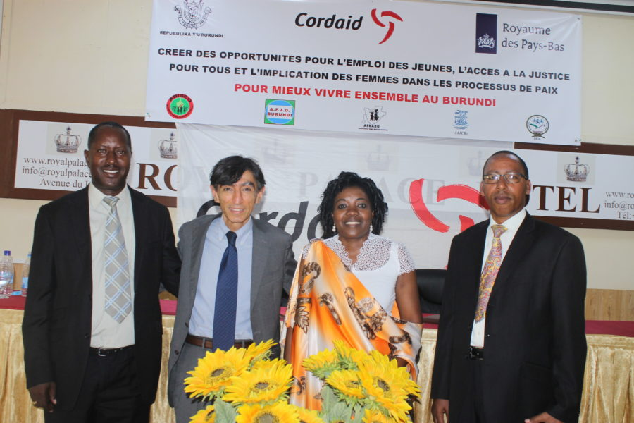 Cordaid Burundi staff posing below the project banner at the official launch ceremony.