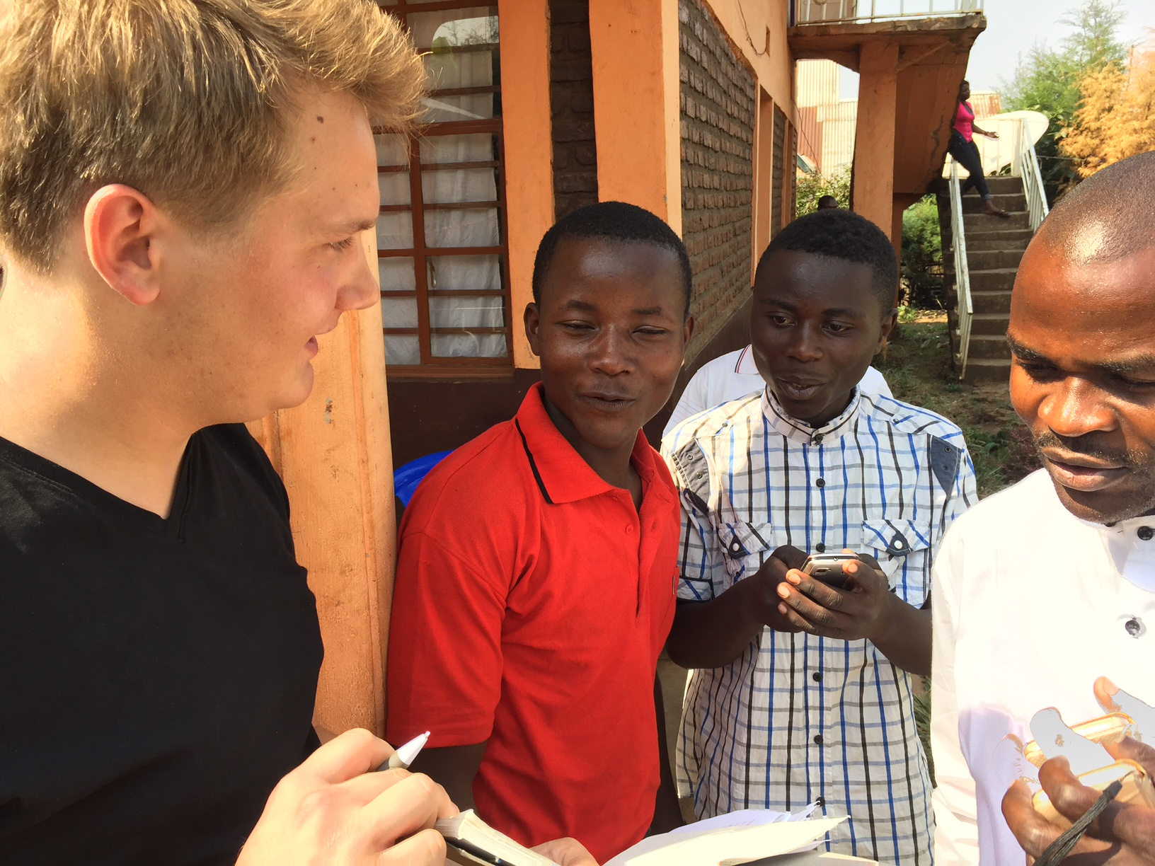 Burton talking with Congolese youth
