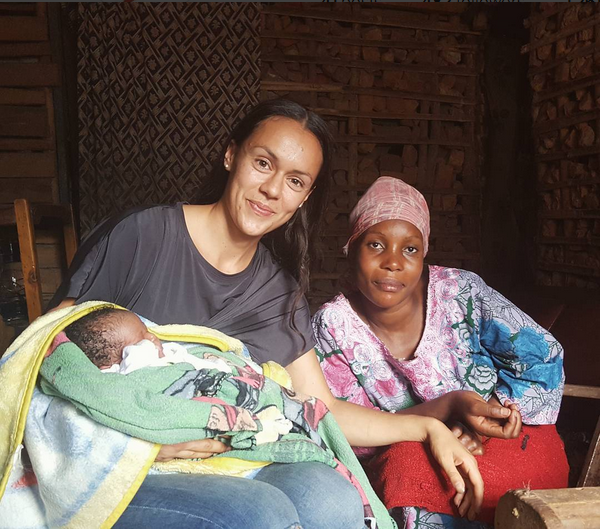 Neda (l) with Maria and her newborn baby